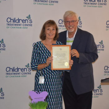 Photo of Rick Nicholls presenting 70th Anniversary certificate to Donna Litwin-Makey