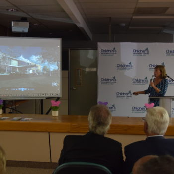 Photo of Donna Litwin-Makey presenting concept photos of the new building