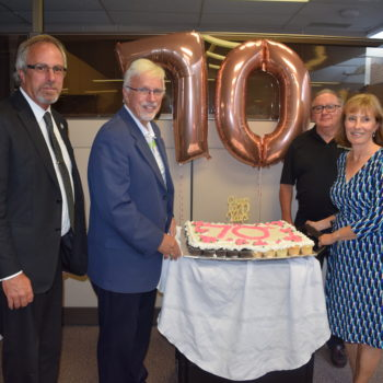 Photo of Rick Nicholls, Mayor Randy Hope, Mike Genge and Donna Litwin-Makey with 70th Anniversary Cake