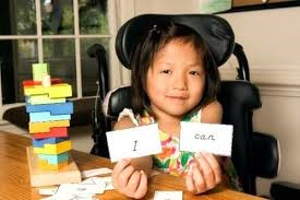 Picture of child holding word cards